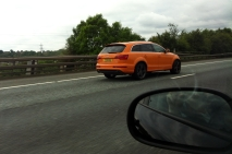 No, your eyes are not deceiving you, that is an orange Audi Q7.