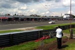 Porsche Carrera Cup race one with Daniel Lloyd charging down the start-finish straight.