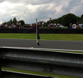 BTCC Race Two; a lonely looking grid girl for Jason Plato, starting from the back after technical issues in the first race.
