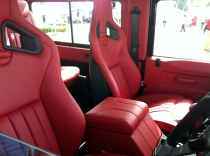 Racing seats, lots of rich, red leather. Whatever could it be?