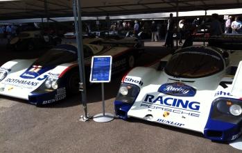 Porsche 956's calmly survey the rest of the paddock.