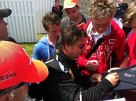 Rene Arnoux, signing some autographs.