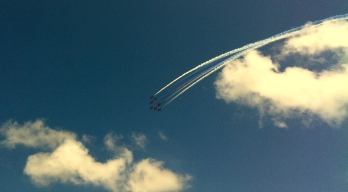 Red Arrows take to the sky as the action continues on track below.