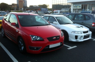 My colleague's Ford Focus ST, chilling with a Mitsubishi Lancer Evo V.