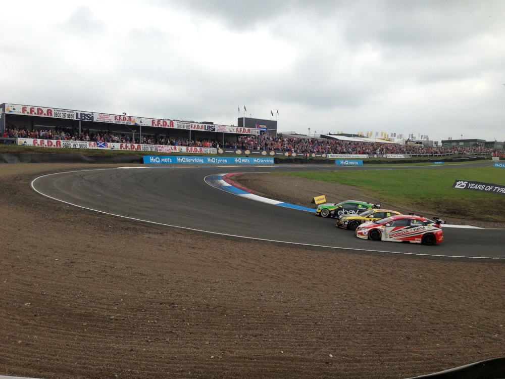 Turkington takes the lead in race one from Austin, closely followed by Shedden