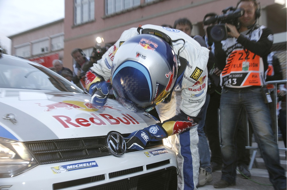 Ogier congratulates his steed - the carbon fibre grilled Polo R WRC.