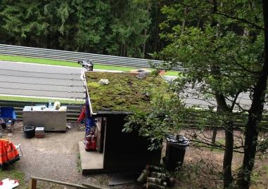 Herr Vettel flies past picturesque marshal's hut.